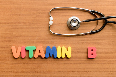 b: vitamin B  colorful word on the wooden background