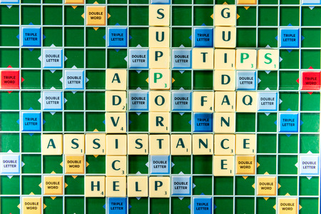 fine tip: June 19, 2015: Dhaka, Bangladesh - assistance support guidance faq tips help Crossword on the colorful game board