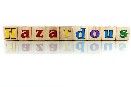 perilous: hazardous colorful wooden word block on the white background Stock Photo