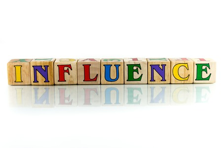 clout: influence colorful wooden word block on the white background