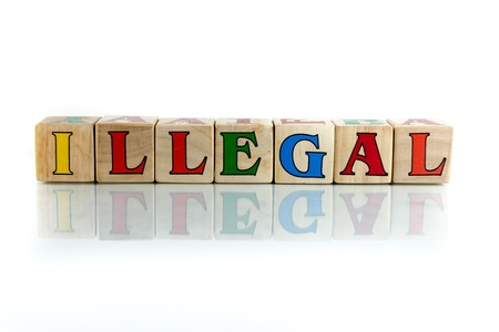 violating: illegal colorful wooden word block on the white background