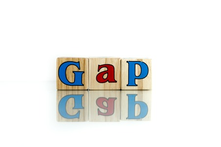 discontinuity: gap colorful wooden word block on the white background