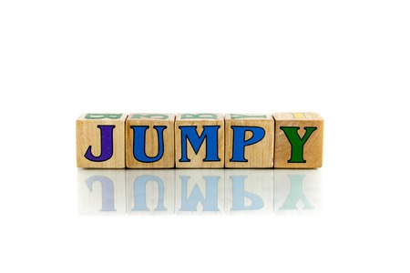 fidgety: jumpy  colorful wooden word block on the white background Stock Photo