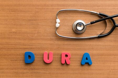 dura: dura  colorful medical word and stethoscope on the wooden background