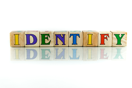 identify: identify colorful wooden word block on the white background Stock Photo
