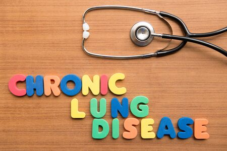 lung disease: Chronic lung disease (CLD) colorful word with stethoscope on the wooden background