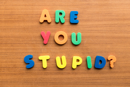 leading education: are you stupid  colorful words on the wooden background Stock Photo