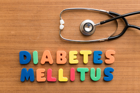 diabetes mellitus  colorful medical word and stethoscope on the wooden background