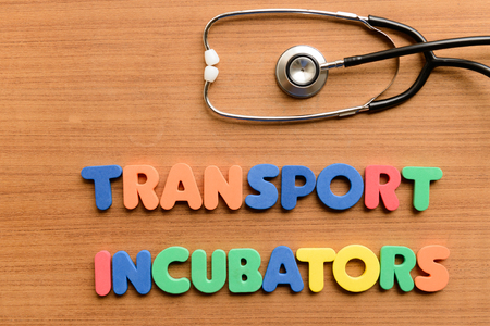 specialised: Transport incubators  colorful word on the wooden background Stock Photo