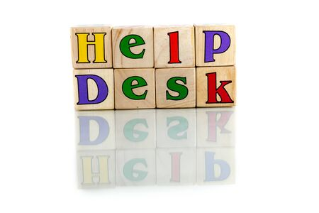 ministration: help desk colorful wooden word block on the white background