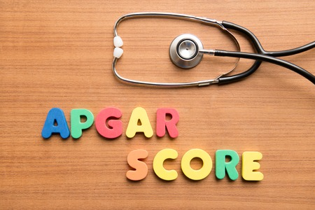 Apgar score colorful word with stethoscope on the wooden background,birth Standard-Bild