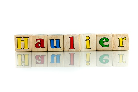 shipper: haulier colorful wooden word block on the white background