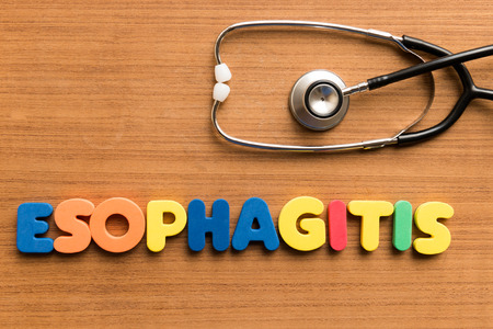 esophageal: esophagitis  colorful medical word and stethoscope on the wooden background