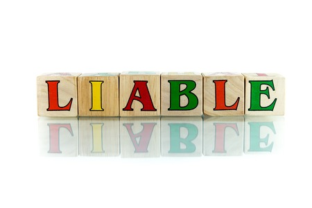 obligated: liable colorful wooden word block on the white background