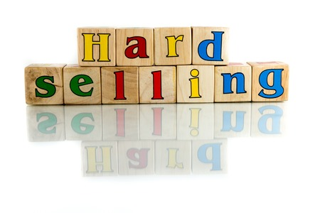 hard selling colorful wooden word block on the white background Фото со стока