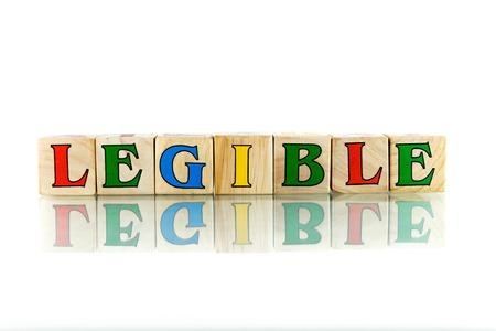 inteligible: colorido bloque de legibles palabra de madera en la fondo blanco