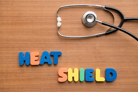 heat loss: Heat shield colorful word with stethoscope on the wooden background