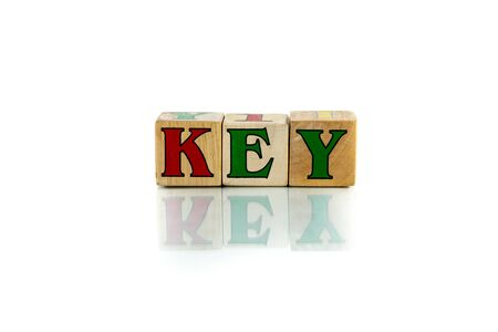 key colorful wooden word block on the white background