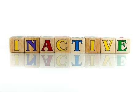 inactive colorful wooden word block on the white background Stock Photo