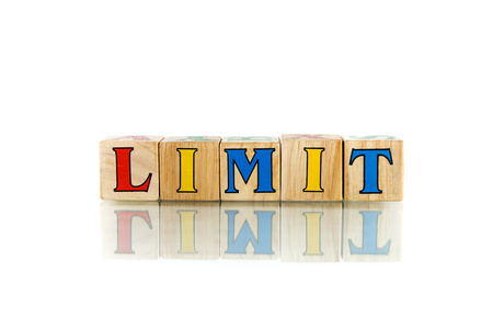bourne: limit colorful wooden word block on the white background