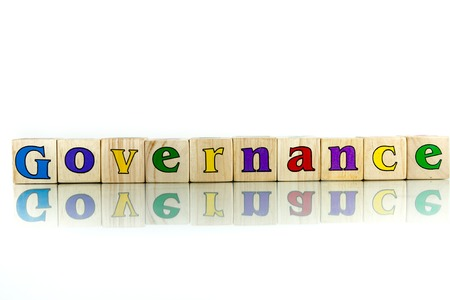 dominion: governance colorful wooden word block on the white background