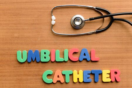 umbilical: Umbilical catheter  colorful word on the wooden background Stock Photo