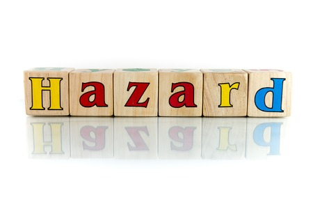 risky business: hazard colorful wooden word block on the white background Stock Photo