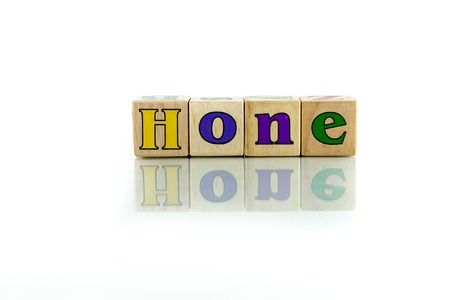 acuminate: hone colorful wooden word block on the white background Stock Photo