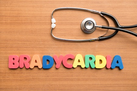 Bradycardia colorful word with stethoscope on the wooden background