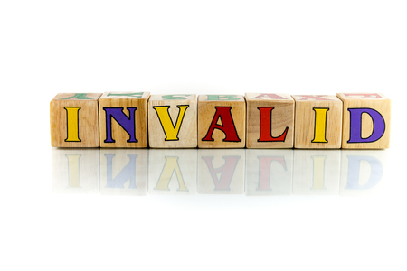 inoperative: invalid colorful wooden word block on the white background