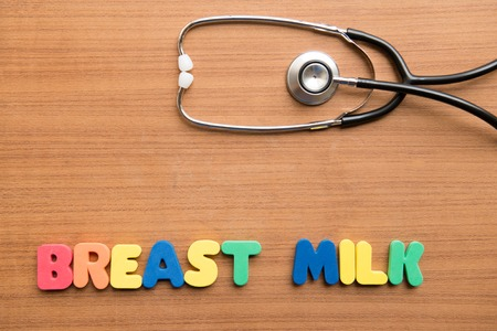 breast milk: breast milk colorful word with stethoscope on the wooden background