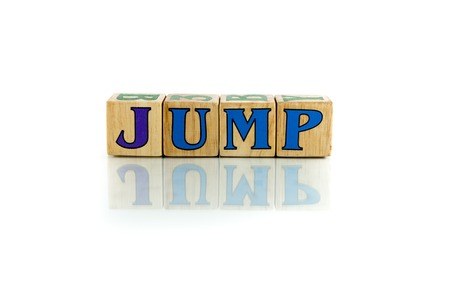 jump colorful wooden word block on the white background Stock Photo