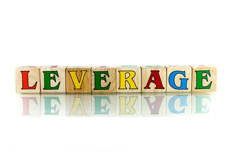 leverage: leverage colorful wooden word block on the white background