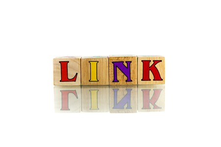 in copula: link colorful wooden word block on the white background Stock Photo