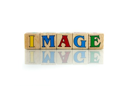 spitting: image colorful wooden word block on the white background