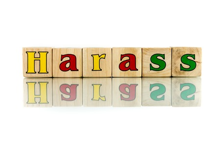 hassle: harass colorful wooden word block on the white background Stock Photo