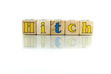 hangup: hitch colorful wooden word block on the white background