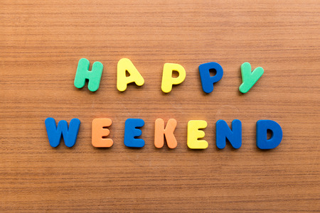 happy weekend  colorful words on the wooden background