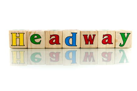 headway: headway colorful wooden word block on the white background