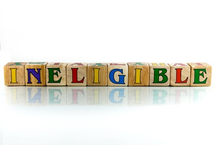 inappropriate: ineligible colorful wooden word block on the white background Stock Photo