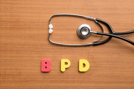 dysplasia: Bronchi Pulmonary Dysplasia (BPD) colorful word with stethoscope on the wooden background