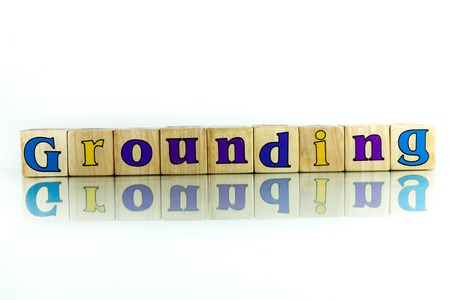 acquaint: grounding colorful wooden word block on the white background