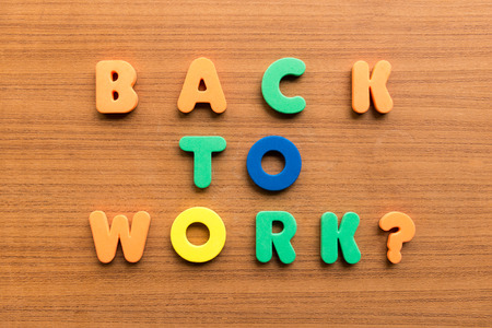 back to work  colorful words on the wooden background