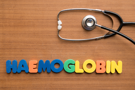 haemoglobin: Haemoglobin colorful word with stethoscope on the wooden background