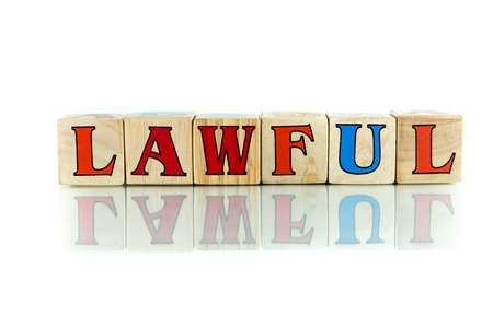 mandated: lawful colorful wooden word block on the white background Stock Photo