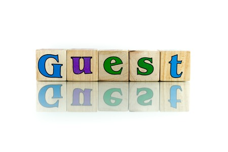guest colorful wooden word block on the white background