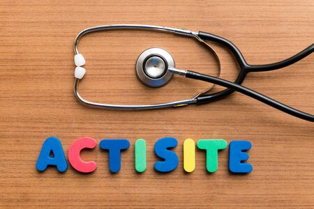 Actisite colorful word on the wooden background Stock Photo