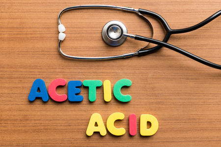 acetic acid: Acetic Acid colorful word on the wooden background