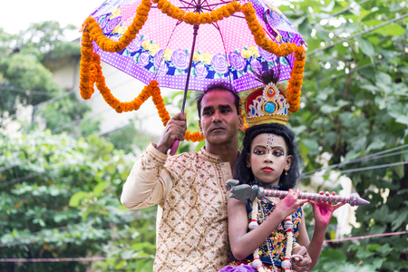 mahabharata: Dhaka, Bangladesh - September 04, 2015: A child dressed as Lord Krishna on the occasion of Janmashtami in Dhakeshwari Mandir, Dhaka, Bangladesh