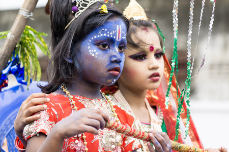 mahabharata: Dhaka, Bangladesh - September 04, 2015: School children dressed as Lord Krishna and Radha celebrate Janmashtami festival in Dhakeshwari Mandir, Dhaka, Bangladesh